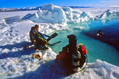 AK expedition member ice diving in Arctic Bay 2004