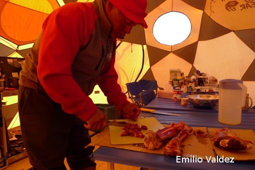 Jake - Senior Arctic Kingdom guide prepares caribou stew