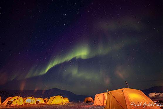 Northern lights above arctic safari camp