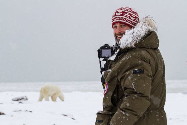 Photographer capturing polar bear photo in the arctic