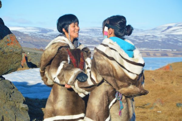 Two Women Holding Each Other While Kataqjjaq Throat Singing