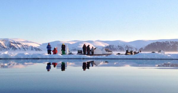 Arctic floe edge with sleds