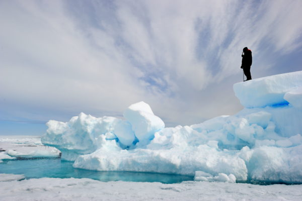 Man standing on glacier in the arctic
