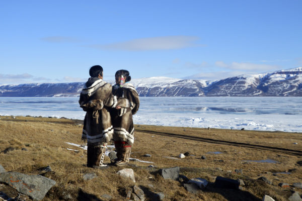 Inuit peoples engaging in throat singing