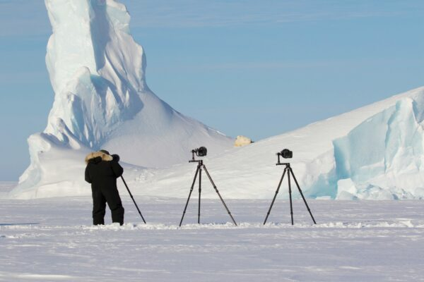 photgraphing a polar bear in the arctic ice