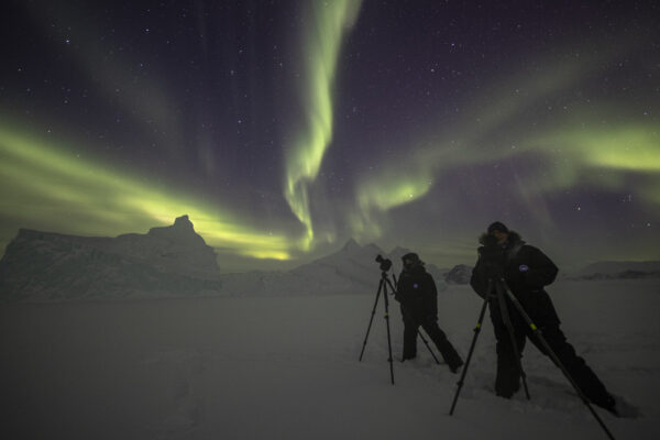 photographers capturing northern lights