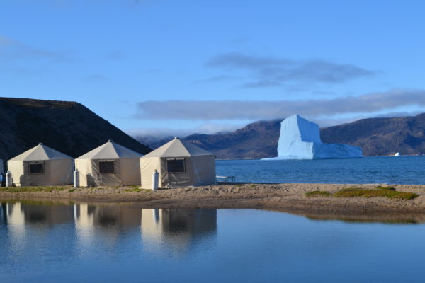 Yurts in the arctic with glacier in the background